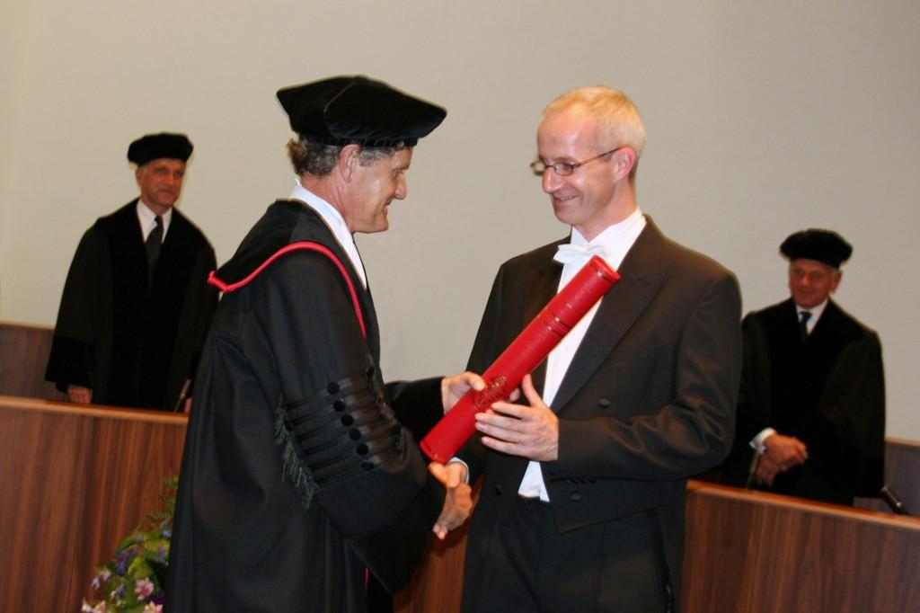 Promotie, met Prof Dr A. van Kampen als promotor.